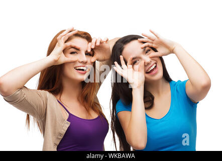 two young teenagers making faces - Stock Photo