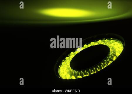 Close-up Of Illuminated Green Led Light Against Black Background - Stock Photo