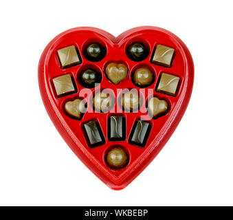 Chocolates In Heart Shape Box Over White Background - Stock Photo