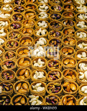 High Angle View Of Various Dried Fruits In Containers For Sale At Market - Stock Photo