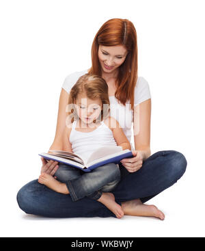 happy mother with adorable little girl and book - Stock Photo