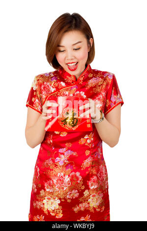 Young Woman Wearing Kimono Holding Purse Against White Background - Stock Photo