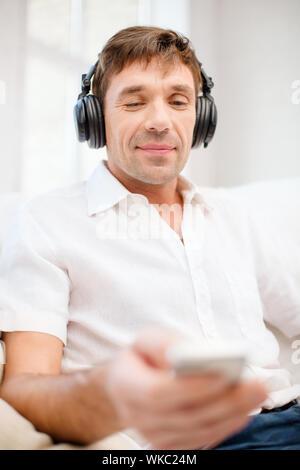 man with headphones listening to music - Stock Photo