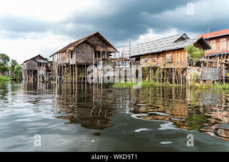 Houses on stilts in Inle lake.The stilts must be high, as the lake level fluctuates severely between the dry and rainy seasons. - Stock Photo