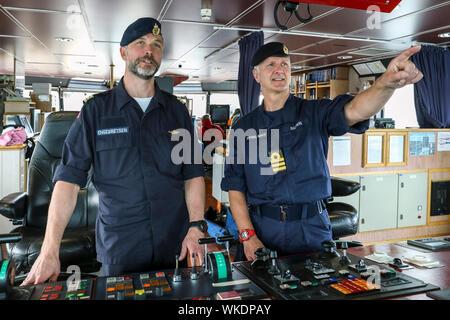 Glasgow, UK. 4th September 2019. The Faslane based NATO Submarine Rescue System (NSRS) was preparing to set sail from Glasgow's King George V Dock to take part in Exercise Golden Arrow on the Firth of Clyde with the teams who operate it the new unique rescue system, jointly owned by UK, France and Norway. The operating teams include Commander CHRIS BALDWIN (Royal Navy) Commander Espin ENGEBRETSEN (Norwegian Navy) and OLIVIA KINGHORN, aged 26, Project Engineer who supervised as the submersible, capable of diving down to 610 metres. Credit: Findlay/Alamy Live News - Stock Photo
