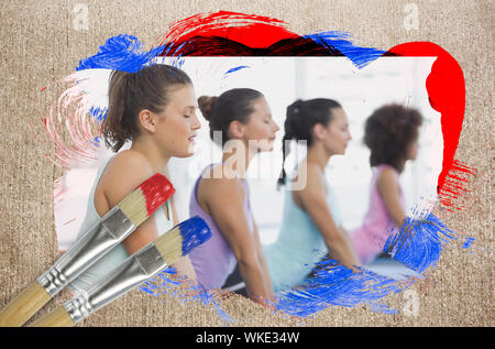 Composite image of yoga class in the gym against weathered surface with paintbrushes - Stock Photo
