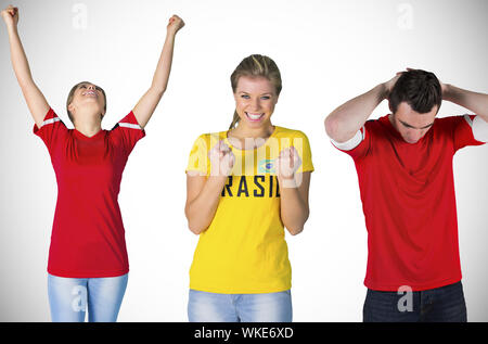 Composite image of football fans against white background with vignette - Stock Photo