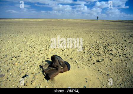 Brown Boot Lying On Ground - Stock Photo