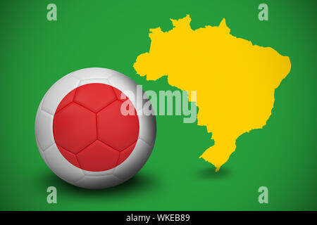 Football in japan colours against yellow brazil outline on green - Stock Photo