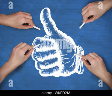 Composite image of multiple hands drawing thumbs up with chalk against navy blue - Stock Photo