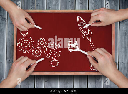 Composite image of multiple hands drawing doodles with chalk on wooden board - Stock Photo