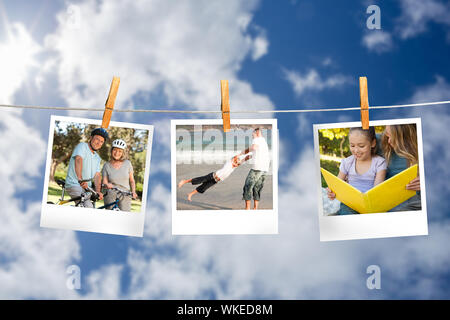 Composite image of instant photos hanging on a line against cloudy sky - Stock Photo