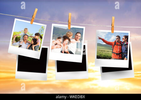 Composite image of instant photos hanging on a line against sunrise sky - Stock Photo