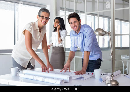 Attractive architects going over plans in the office