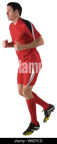 Football player in red running on white background - Stock Photo