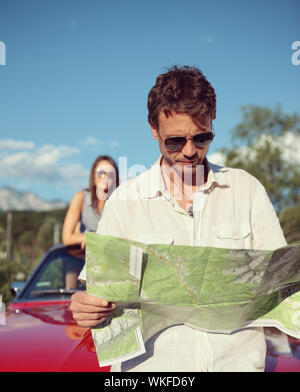 Beautiful couple trying to find their way - Stock Photo