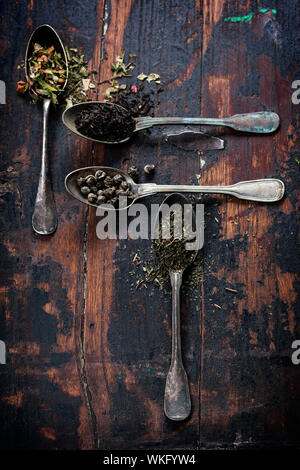 Various kinds of tea (black, green and herbal) on wooden background - Stock Photo