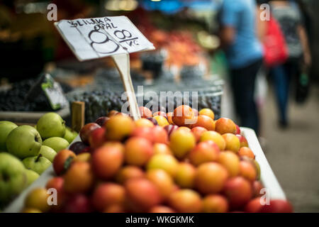 Close-up Of Red Plums On Stall At Market For Sale - Stock Photo