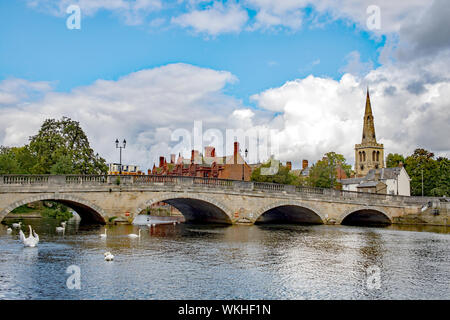 Bedford town bridge in Bedfordshire, England, UK spanning the River Great Ouse, with the spire of St Paul's Church in the background - Stock Photo