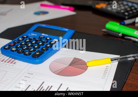 Close-up Of Graph Papers With Pen And Calculator On Table - Stock Photo