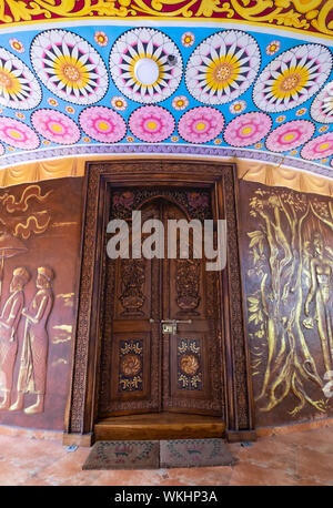 KANDY, SRI LANKA - AUGUST 05-2019: The temple in Kandy city, Sri Lanka. The door made from the wood. It's one of famous temple for travel. - Stock Photo