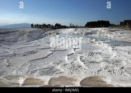 PAMUKKALE, TURKEY - MAY 04, 2010 : The incredible travertines, otherwise known as Cotton Castle in the late afternoon. The travertines were formed ove - Stock Photo