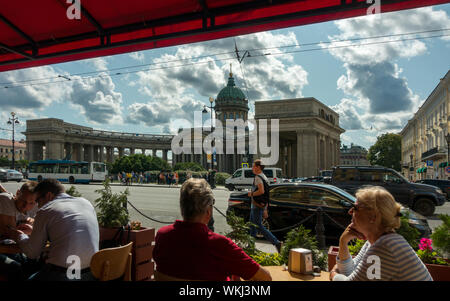 Cafe scene on Nevsky Avenue looking across to Kazan Cathedral in summer, St Petersburg, Russia - Stock Photo