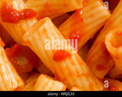 close up of maccheroni pasta in tomato sauce food background - Stock Photo