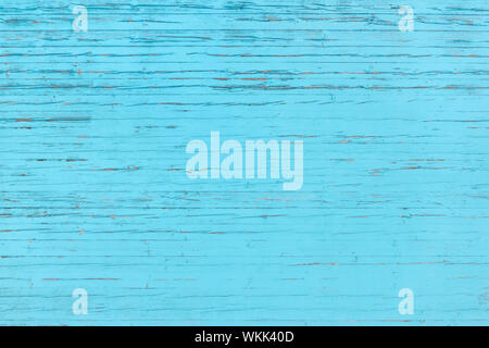 Light blue, partly heavily weathered wooden wall - Stock Photo