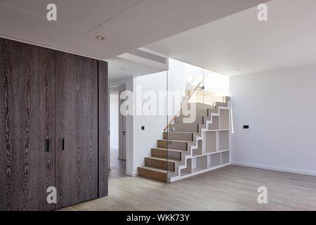 Apartment stairway. Faraday House at Battersea Power Station, London, United Kingdom. Architect: dRMM (de Rijke Marsh Morgan Architects), 2017. - Stock Photo