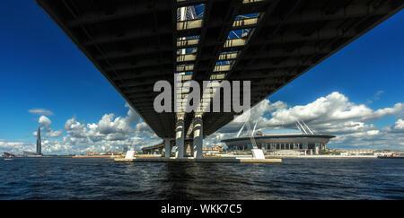 Underneath the bridge over the Gulf of Finland with Krestovsky stadium (Zenit Arena) and Lakhta Center skyscraper - Stock Photo