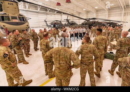 OPA-LOCKA, FLORIDA, FLORIDA (2 September 2019) -- Florida National Guard Soldiers and Airmen, from the CBRN Enhanced Response Force Package (CERFP), load equipment and prepare for potential missions responding to Hurricane Dorian, September 2, 2019. (Photo by Ching Oettel). () - Stock Photo