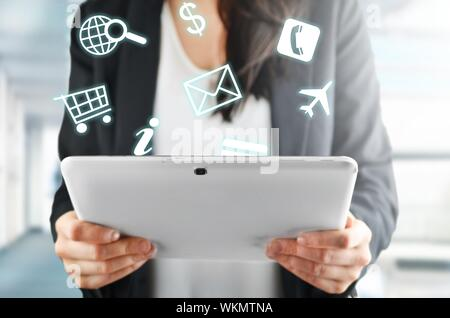 Businesswoman with tablet using ecommerce. - Stock Photo
