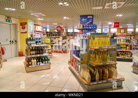 LINATE, ITALY - CIRCA NOVEMBER, 2017: goods on display at Milan Linate Airport. - Stock Photo