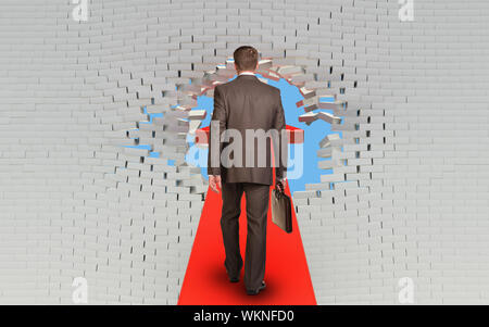 Businessman with briefcase walking on arrow pierced brick wall - Stock Photo