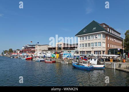 boats and houses, Alter Strom (old river), Warnemünde, Rostock, Mecklenburg-West Pomerania, Germany - Stock Photo