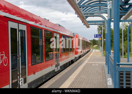 leaving train at countryside train station, Meckenheim/NRW/Germany-09-03-2019 - Stock Photo