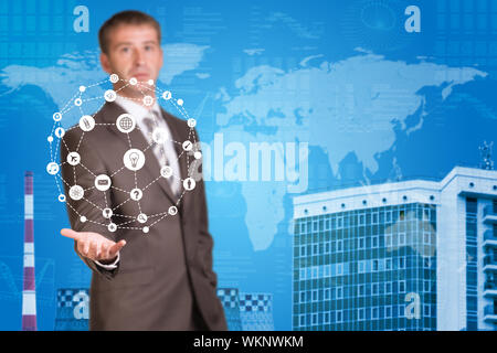 Business man hold cloud icons in hand. Building and world map as backdrop - Stock Photo