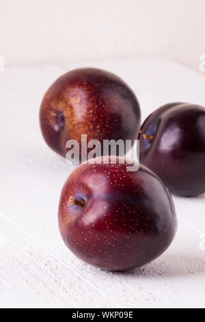 Fresh ripe red plums - Stock Photo