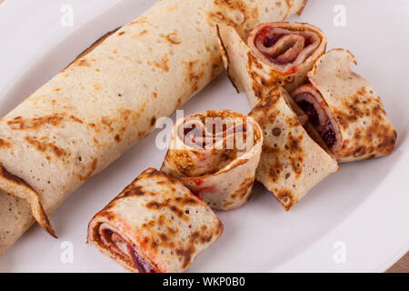 Sweet Rolled Pancakes on Plate - Stock Photo