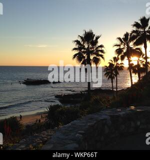 Scenic View Of Laguna Beach Against Sky During Sunset - Stock Photo