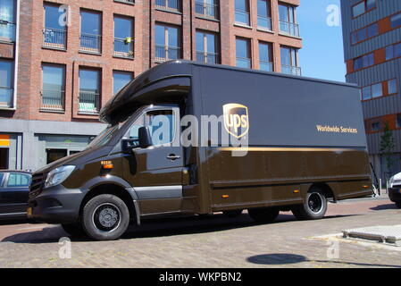 Almere Poort, Flevoland, The Netherlands - May 13, 2016: UPS delivery Truck parked by the side of the road in front of a building. - Stock Photo