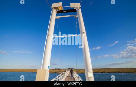Tavira, Portugal - October 14th, 2018:  Tavira Island pedestrian drawbridge, built to access by land to Barril Beach, Algarve, Portugal - Stock Photo