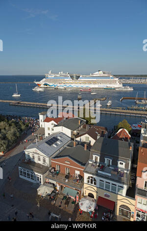 cruise ship AIDAdiva leaving Warnemünde, Rostock, Mecklenburg-West Pomerania, Germany - Stock Photo