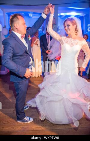 Full Length Of Wedding Couple Dancing During Ceremony - Stock Photo