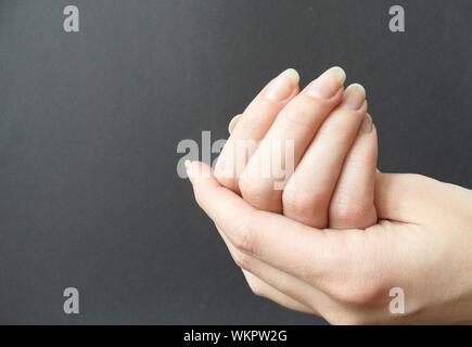 Close-up Of Woman Cupping Hands - Stock Photo