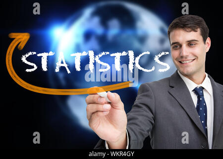 Businessman writing the word statistics against glowing earth with binary code - Stock Photo