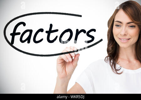 Businesswoman writing the word factors against white background with vignette - Stock Photo