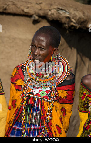 Adult Maasai Woman wearing traditional beaded necklace, jewelry, earrings, village near the Masai Mara, Kenya, East Africa - Stock Photo