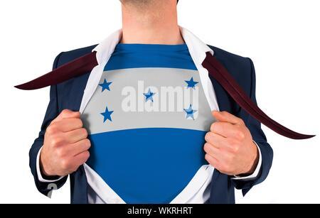 Businessman opening shirt to reveal honduras flag on white background - Stock Photo